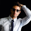 Attractive, elegant young man with shirt, tie and sunglasses — Stock Photo