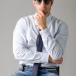 Handsome young man wearing shirt, necktie and ripped jeans — Stock Photo