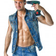 Handsome, muscular construction worker pointing drill against head — Stock Photo
