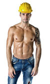 Handsome, muscular construction worker shirtless on white — Stock Photo