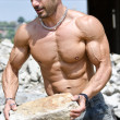 Muscular construction worker shirtless in building site — Stock Photo