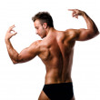 Attractive young muscular man naked posing, seen from the back — Stock Photo