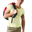 Handsome young man with backpack, isolated on white — Stock Photo