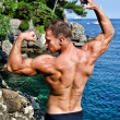 Muscular young bodybuilder outdoors — Stock Photo