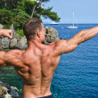 Muscular young bodybuilder outdoors — Stock Photo #34652903
