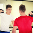 Two young men in gym working out with kettlebells — Stock Photo #34656125
