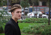 Attractive blue eyed, blond young man outdoors in city — ストック写真