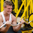 Handsome young man training biceps in gym — Photo