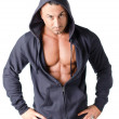 Musclemwith open blue hoodie isolated on white — Stock Photo #36866119