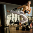 Shirtless young man doing flying kick — Stock Photo #36866225