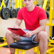 Young male personal trainer holding clipboard — Stock Photo