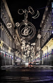 Via Roma in Turin, Italy, lit up by Christmas lights — Stock Photo