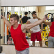 Stock Photo: Young mtraining pecs on gym equipment
