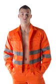 Handsome young construction worker with orange suit — Stock Photo