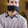 Stock Photo: Gagged young mcannot speak