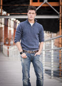 Handsome young man in industrial environment — Stock Photo
