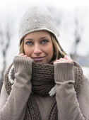 Attractive blonde young woman with wool scarf and hat — Stock Photo