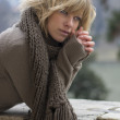 Attractive blonde young woman outdoors in winter — Stock Photo