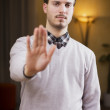Handsome, seerious young man doing stop sign with hand — Stock Photo