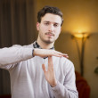 Attractive young man doing time-out sign — Stock Photo