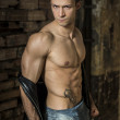 Muscular shirtless young man with jeans, indoors. — Zdjęcie stockowe #42820611