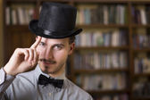Attractive young man wearing top hat and bow tie — Stock Photo