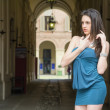 Elegant young woman next to gallery in european city — Stock Photo #45705443