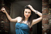 Elegant attractive young woman on threshold — Stock Photo