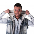 Handsome smiling young man with hoodie and denim vest — Stock Photo #48151461