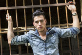 Handsome black haired young man in denim shirt — Stock Photo