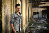 Handsome young man in abandoned, run down building — Stock Photo