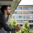 Profile shot of attractive bearded young man in city — Stock Photo #48969481