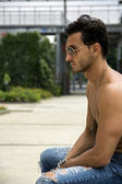 Handsome shirtless man outdoor in urban environment — Stock Photo