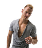 Fit male model smiling and pointing — Stock Photo