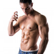 Shirtless male model spraying cologne — Stock Photo #51395923
