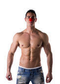 Red clown nose on Sexy Man — Stock Photo