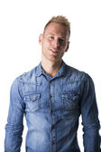 Blond young man in denim shirt — Stock Photo