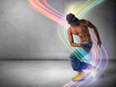 Young man in a hat doing a break dance — Stock Photo