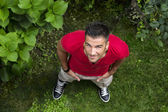 Fit male model looking up — Stockfoto