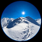 Fisheye lens image of Negoiu peak in winter — Stock Photo