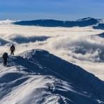Climbing the mountain in winter — Stock Photo