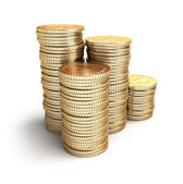 Golden coins in piles. — Stock Photo