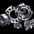 Detailed bearings production over black — Stock Photo #35601343