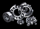 Detailed bearings production over black — Stock Photo