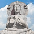 Buddha and blue sky background — Stock Photo