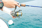 The fisherman with a fishing reel — Stockfoto