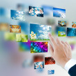 Stock Photo: Men hand using touch screen interface with pictures in frames