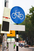 Bicycle lane sign indicating bike route, blue roadside traffic s — Stock Photo