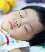Asian newborn baby lying on bed — Stock Photo