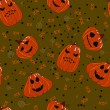 图库矢量图片: Halloween seamless background with pumpkin scary jack